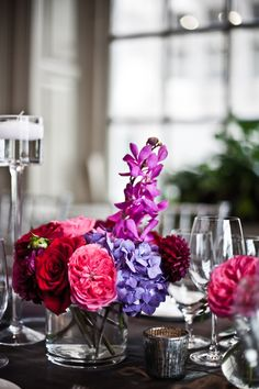 TableArt- Wedding- One of many arrangements that create the rectangular tablescape. A petite collection of Purple orchids, fuchsia garden rose, red roses, purple hydrangea, purple dahlia {Venue: Davio's Northern Italian Steakhouse | www.TableArt.Net}