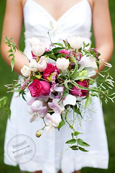 Bridal bouquet with Phalaenopsis Orchids, Dendrobium Orchids, Flowering Jasmine Vine Tulips, Kiss Me By The Garden Gate Flowers, Roses, Dusty Miller and Tillandsia (air plant)*