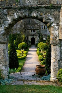 Abbey House, Malmesbury, Wiltshire. The Saxon Arch with path leading through to the Main House.