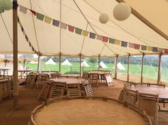 A honeycomb marquee wedding with bell tent Glamping in the field. Paper lantern lights, amazing Indian bunting and coir Matting to make This wedding any brides dream.   Real canvas makes such a difference