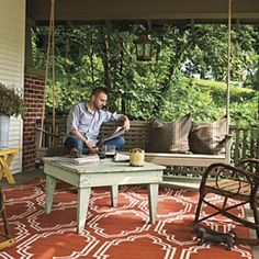 Bungalow Porch An extra-long porch swing anchors this porch space and, at 7 feet long, invites stretching out for long afternoon naps. The swing is hung the swing by ropes to give it a more natural look. A brightly patterned outdoor rug pops against neutral tones.