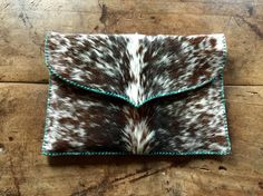 A cowhide lap top case lined and stitched in turquoise suede. From gowestdesigns.us