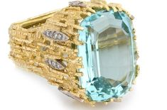 Amazing Andrew Grima ring set in 18k textured gold, diamonds and a large flawless aquamarine. (Untitled ring, ca. 1965). .…