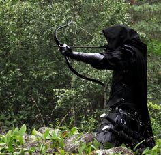 He came out of the trees completely cloaked in black and a bow at the ready. The arrows didn't even make a noise as they were shot through the air and to their targets.