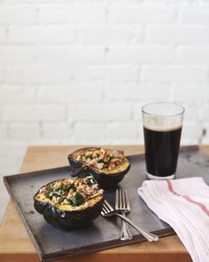 ROASTED ACORN SQUASH BOWLS WITH BARLEY SPINACH SALAD... Squash bowls make for a great center piece. This is a nice and simple recipe. Replace butter with olive oil. I might also suggest adding a can (15oz) of cannellini beans or bits of Field Roast sausage for added protein...