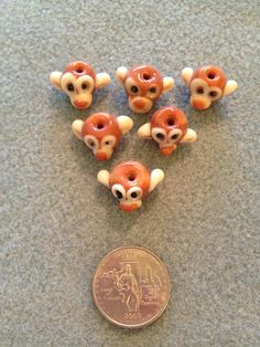 Glass Monkey Head Beads by BeadingBeeCreations on Etsy, $4.99
