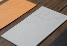 Karina Lax business card with blind deboss detail designed by Teacake.