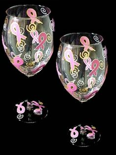 "This charming set of (2) 16oz. wine glasses stand 9"" tall and are beautifully hand painted with the bold pink breast cancer awareness ribbons. This joyous design was create to celebrate the life of survivors and is the perfect positive hopeful gift for those recently diagnosed.    Become aware as you Care: ""Working To Make Things Better""    All profits will be donated to the American Cancer Society."