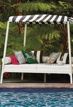 Our spectacular Reef Daybed brings seaside luxury to your outdoor space with a classic cabana aesthetic, and is well appointed with Stamskin – a luxurious faux leather – cushions and backrests.