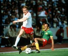 Poland 0 Cameroon 0 in 1982 in La Coruna. Zbigniew Boniek goes by Jacques N'Guea in Group 1 at the World Cup Finals.