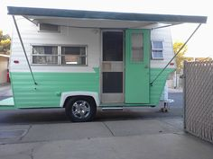 """Renovated my 72 Shasta Loflyte with new paint and retro Z design, Chrome Hubcaps, Dometic AE Trimline Bag Awning, Solar Panels and """"Cabin"""" themed interior."""