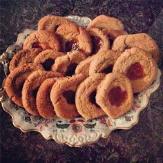 Homemade Rustic almond flour sugar thumb print cookies with rose apricot jam. #zacposen #cookingwithzac