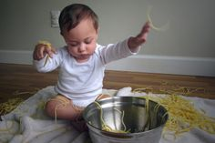 bowl and pasta gave him/her.He/She plays happily.His/Her age is one or one and half years.