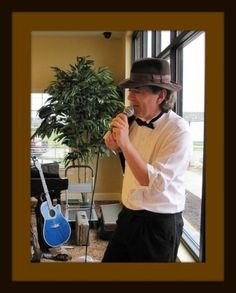 Saxophone, Vocals and Guitar articles, pics and information about John Scott solo performer.  He plays at retirements centers, cafe's and tours to Wisconsin, michigan and Missouri.