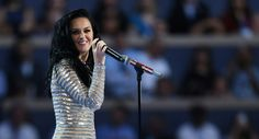 Singer Katy Perry speaks on behalf of Hillary Clinton and gives a performance. (Getty)