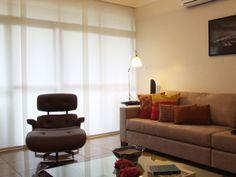 Sala de estar | Iluminação | Cadeira Eames | Charles & Ray Eames | Luminária | marcelasantiago.com.br