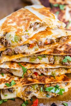 Philly Cheesesteak Quesadillas - Done in under 30 minutes and a make-ahead recipe. Flour tortillas filled with steak and cheese cooked until the tortillas as crisp and cheese is melted. #phillycheesesteakquesadilla #cheesesteakquesadilla #quesadillarecipe #quesadillas #natashaskitchen Diner Recipes, Kitchen Recipes, Mexican Food Recipes, Beef Recipes, Cooking Recipes, Ethnic Recipes, Recipes Dinner, Cooking Ideas, Kitchen Ideas