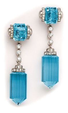 Art Deco barrel-cut aquamarine, diamond and platinum long drop earrings.