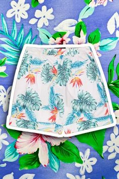 """Aloha Print — To appeal to a wider range of customers during the Great Depression, Honolulu resident Ellery Chun began selling short-sleeved shirts made of leftover Japanese kimono fabric, which included designs with palm fronds, hula girls, and pineapples. The """"Aloha"""" shirt has since evolved into all manners of clothing, and became a staple of Hawaiian fashion.    <sm..."""