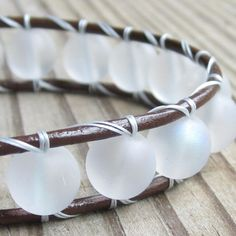 necklaces made with rounded leather macrame and beaded | brown leather single-wrap bracelet with big opaque frosted white beads