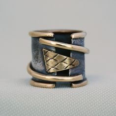 Ring | Cyndie Smith.   Silver and brass