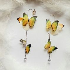 Asymmetric design earrings, as like in Butterfly garden Butterflies sat on your earrings and lightly flutter their wings for you, so unique feelings! And the tiny little butterflies look so gently, completing the whole romantic look of the earrings! Cute Jewelry, Charm Jewelry, Diy Jewelry, Jewelry Accessories, Handmade Jewelry, Diy Fabric Jewellery, Garnet And Gold, Butterfly Earrings, Designer Earrings