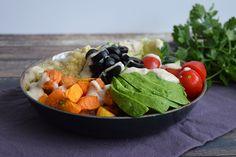 Quinoa bowl with sweet potato and tahini dressing