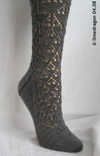Lace socks worked cuff-down with double-point needles, inspired by Marianne Kinzel's 'English Crystal Design.'
