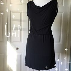 "Black Knit Dress Classy and versatile black stretchy knit dress by Gap. ▪️Elastic waist ▪️Drapey neckline ▪️35"" long ▪️Fits true-to-size ▪️Like new  🚭 Smoke-free home 📬 Ships by next day 💲 Price negotiable  🔁 Open to trades  💟Happy Poshing!💟 GAP Dresses"
