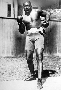 Jack Johnson became the first African-American to win the world heavyweight championship by defeating Tommy Burns by TKO on Dec. 26, 1908