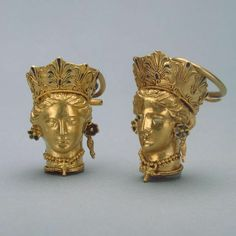 Ancient hellenistic gold and enamel earrings in the form of woman's head. Kerch, Crimea. 350 BC.Hermitage Museum