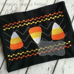 Candy Corn Smock Available in sizes: 4x4 and 5x7  formats: DST, EXP, HUS, JEF, PES, SEW, VIP, VP3, and XXX.  This is a digital embroidery design for use on an embroidery machine. Due to the electronic nature of this product, all sales are final.