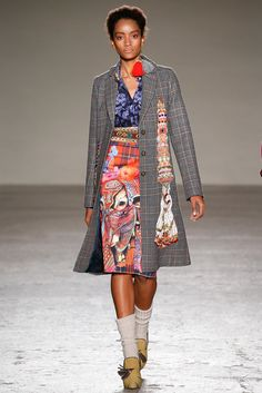 """Stella Jean Fall 2015 Ready-to-Wear - Collection - Gallery - Style.com  Not sure how to feel about the obvious 'borrowing' from East Asian cultures in this show. Stella Jean's work is nuanced, intelligent, and complex, but the """"people as fabric prints"""" choice has us a little leery.  http://www.style.com/slideshows/fashion-shows/fall-2015-ready-to-wear/stella-jean/collection/3"""