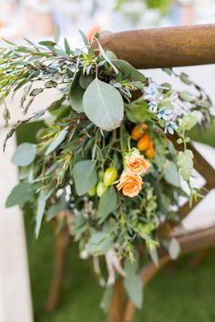 eucalyptus chair decor - photo by Ana and Jerome Photography http://ruffledblog.com/destination-wedding-in-cabo-with-citrus