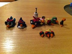 My 5 yr old kid so opsessed with angry birds, he's creating them with modeling clay!  This photo contain some of the Angry birds Space version