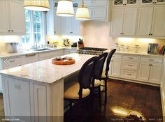 Beautiful white cabinets and marble countertops in this Harwich, Cape Cod kitchen.