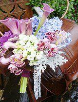 Atlanta Wedding Bridal Bouquet design featuring floral content in shades of purple from Al Dellinger of www.2000adinc.com