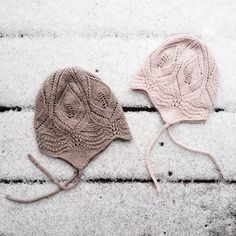 Lace hat with earflaps.