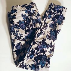 SaleFree People Cords Gently used once. The pants are a light grey color with a blue floral print . Even though they are my correct size, they fit me big since the material is stretchy. They are basically new! Free People Pants Ankle & Cropped