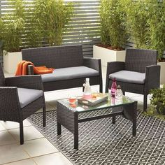 Complete with a tempered glass coffee table and cream padded seat cushions, this four seat conversation set features a hand woven rattan sofa and chairs that bo. Rattan Garden Furniture Sets, Yard Furniture, Garden Sofa, Outdoor Furniture Sets, Outdoor Decor, Furniture Design, Grey Seat Pads, Rattan Sofa, Living Room Designs