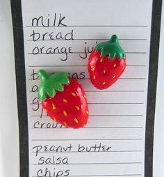 A sweet pair of strawberry magnets. These strawberries look good enough to eat. They would look deliciously delightful on your refrigerator to