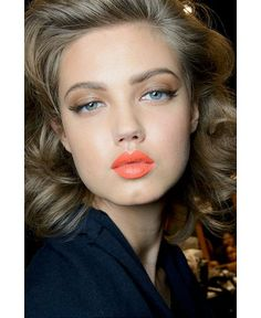 Bronzed, Orange matte lip, shiny eyelids, eye flicks and an amazing eyebrow. Look of the Summer. Summer Beauty trend 2013/14.