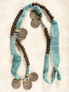 Vintage coins, silk & wooden beads. Gorgeous necklace.