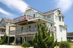 Seaside 61 | Nags Head Rentals | Village Realty. 5 bedrooms, 4 full baths, 1 half bath. Pool, Hot Tub, WiFi. .    Other amenities at 'Seaside 61' include: 2 master bedrooms, hot tub, rec room with shuffleboard, bumper pool table, grill, outside shower, and covered parking