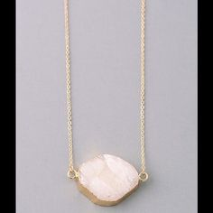 Kylie Fire & Ice Necklace Kylie Fire & Ice Necklace. Gorgeous druzy stone necklace in white pearl. Perfect for any season! Jewelry Necklaces