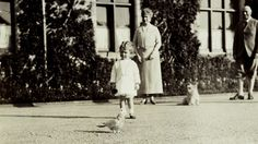 This photograph of The Queen, when Princess Elizabeth, was taken at Balmoral by her father, King George VI, when Duke of York. Princess Elizabeth watches Charlotte the parrot, with Queen Mary, her brother Alexander Earl of Athlone, and Snip, the King's terrier.