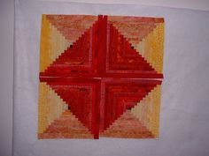 Red and yellow log cabin blocks