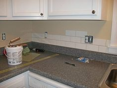 Subway Tiles For Kitchen white cabinets, soapstone counters, grey subway tiles, wood floors