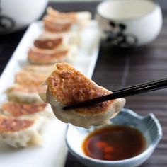 Gyoza are Japanese dumplings. Not to be confused with goza, the Japanese portable grass mat you sit on at the beach or picnics. Japanese Gyoza, Japanese Dumplings, Japanese Food, Japanese Appetizers, Asian Appetizers, Appetizer Recipes, Snack Recipes, Dumpling Filling, Homemade Dumplings