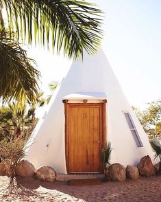"""This deluxe teepee at Pachamama—a yoga retreat and boutique hotel located just outside the small village of Todos Santos, Mexico—pretty much epitomizes what we'd call """"glamping goals."""" Click the link in our bio for 28 of the coolest glamping sites around the world. Photo by @jillianguyette #traveldeeper"""